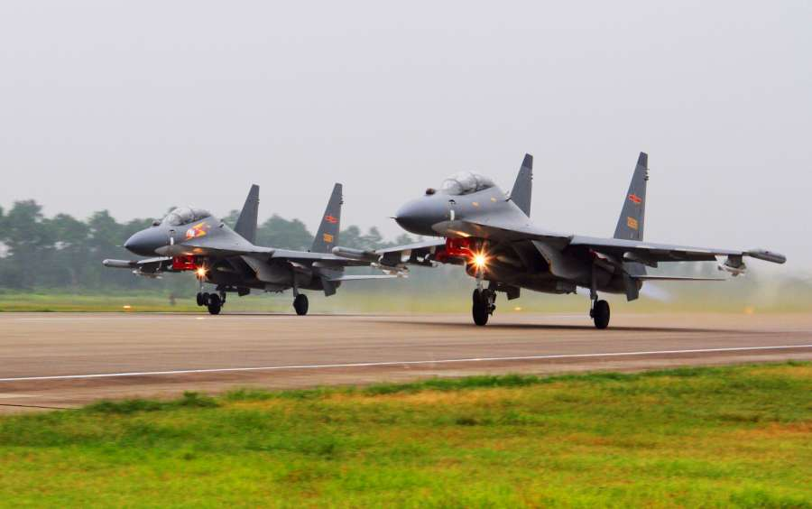 Two Su-30 fighters take off to partol over the South China Sea. Chinese Air Force aircraft, including H-6K bombers and Su-30 fighters, have completed a patrol of airspace above the Nansha and Huangyan islands in the South China Sea, said a spokesperson Saturday. The flight is part of actual combat training to improve the Air Force's response to security threats, said Senior Colonel Shen Jinke of the People's Liberation Army (PLA) Air Force