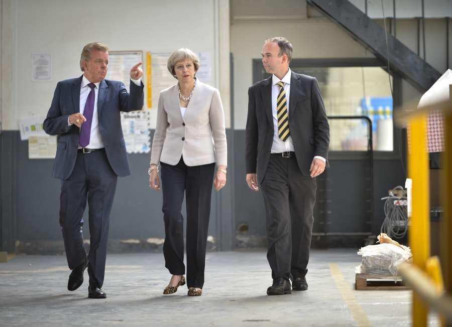 British Prime Minister Theresa May visiting a plant (File)