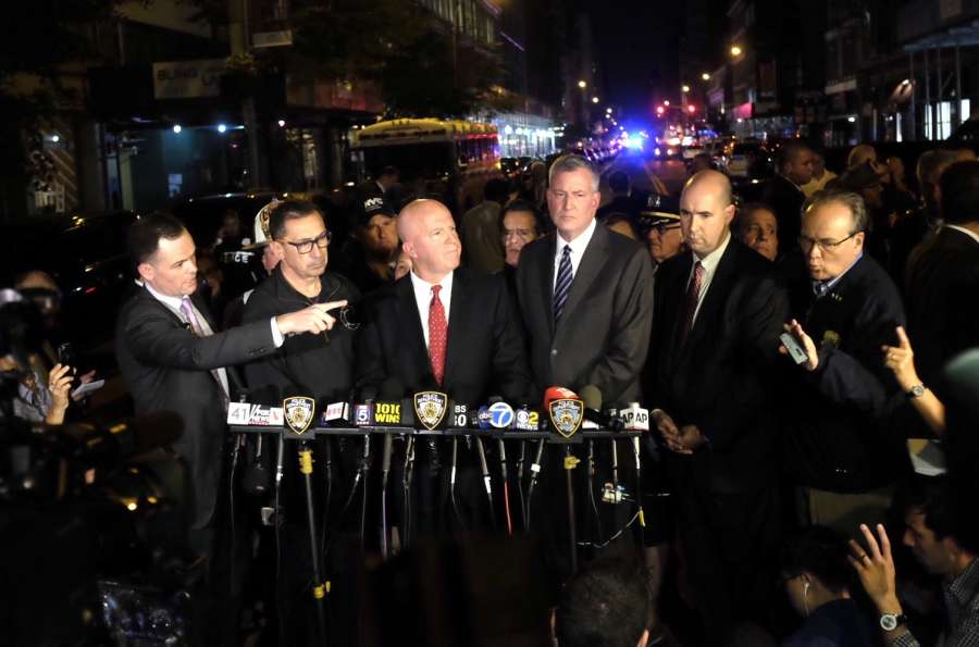 "New York Police Department Commissioner James O'Neill (3rd L) and New York City Mayor Bill de Blasio (3rd R) give a news conference near the blast site in New York, U.S., Sept. 17, 2016. New York City Mayor Bill De Blasio said Saturday that there is ""no evidence at this point of a terror connection"" to an explosion in New York Saturday evening"