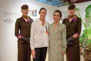 Caroline Rush, Chief Executive of the British Fashion Council, joins Amina Taher, Head of Corporate Communications at Etihad Airways, and the airline's cabin crew at the launch event in London