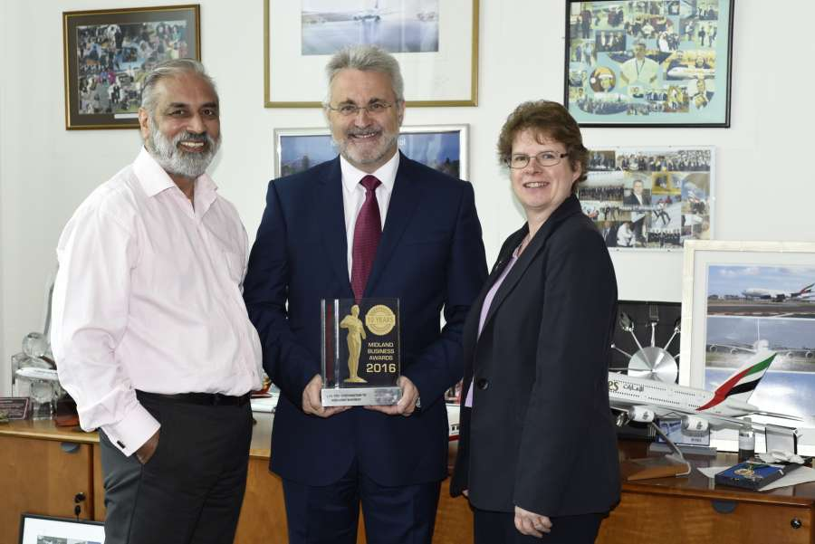 Paul Kehoe receives his trophy from Harjinder Singh Sandher, Founder & Director of the Midlands Business Awards as  Christine Hamilton, Acting Regional Director, UK Trade & Investment looks on