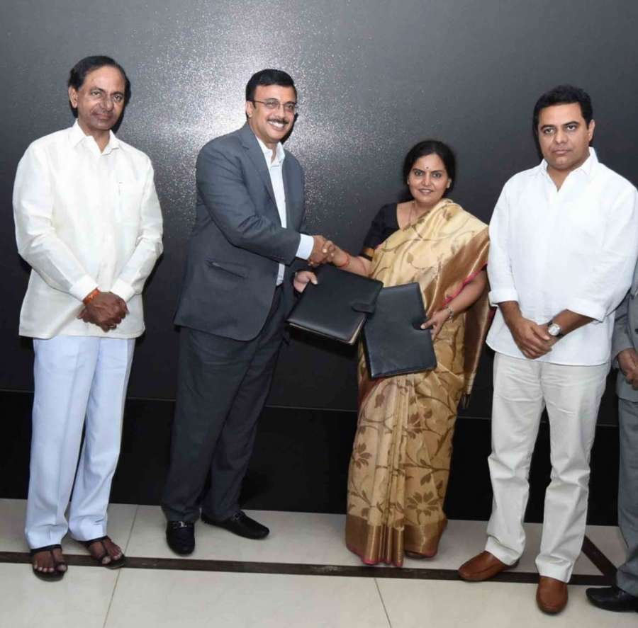 Ashok Leyland Managing Director Vinod Dasari signs MoU with Telangana Government to set up a manufacturing plant in the state at an investment of Rs 500 crore in presence of Telangana Chief Minister K Chandrasekhar Rao and Industries Minister K T Rama Rao in Hyderabad