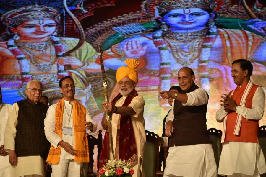 Prime Minister Narendra Modi being welcomed on stage, at Aishbagh Ram Leela, in Lucknow, on Oct 11, 2016. Also seen Uttar Pradesh Governor Ram Naik and Union Home Minister Rajnath Singh.
