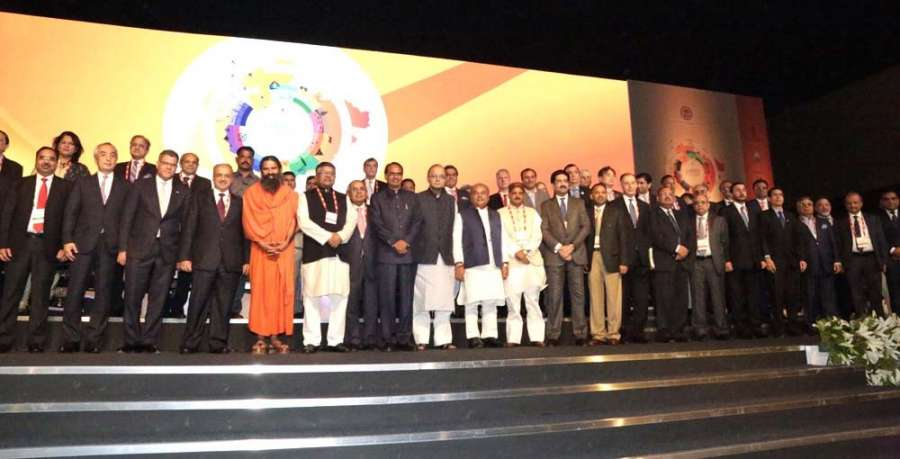 Union Law Minister Ravi Shankar Prasad, Union Finance Minister Arun Jaitley, Union Rural Development Minister Narendra Singh Tomar, Madhya Pradesh Chief Minister Shivraj Singh Chouhan, Reliance Group Chairman AnilAmbani, Aditya Birla Group Chairman Kumar Mangalam Birla and Yoga guru Baba Ramdev during the inauguration of the Fifth Global Investor's summit in Indore