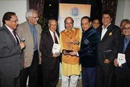 Mr Vijay Jolly being presented the Pride of India Award by Mr Atul Pathak OBE, President of the Punjabi Society of the British Isles