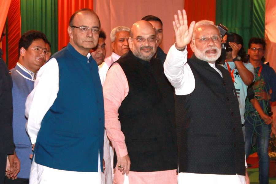 "Prime Minister Narendra Modi, Union Finance Minister Arun Jaitley and BJP chief Amit Shah during ""Diwali Mangal Milan"" programme at the BJP headquarters in New Delhi"