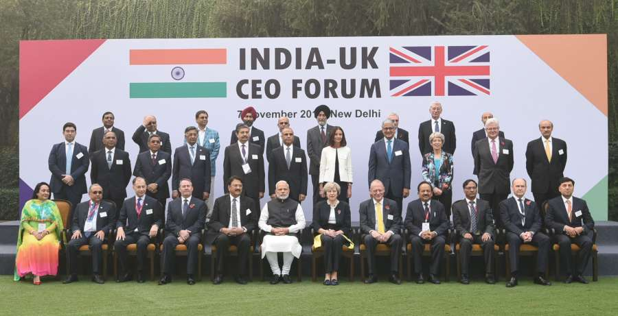 modi-and-the-prime-minister-of-united-kingdom-ms-theresa-may-in-a-group-photograph-of-the-india-uk-ceo-forum-in-new-delhi