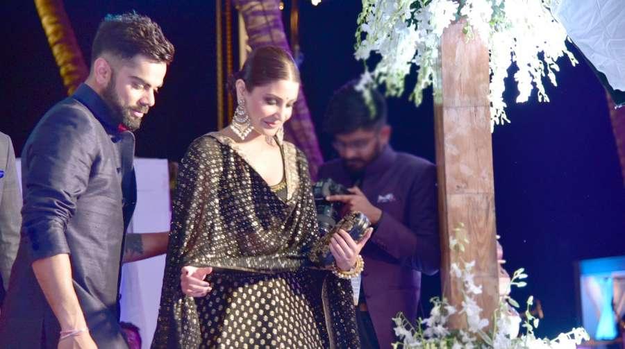 Siolim: Cricketer Virat Kohli with actress Anushka Sharma during wedding ceremony of Yuivraj Singh and Hazel Keech in Siolim, Goa on Dec 2, 2016. (Photo: IANS)