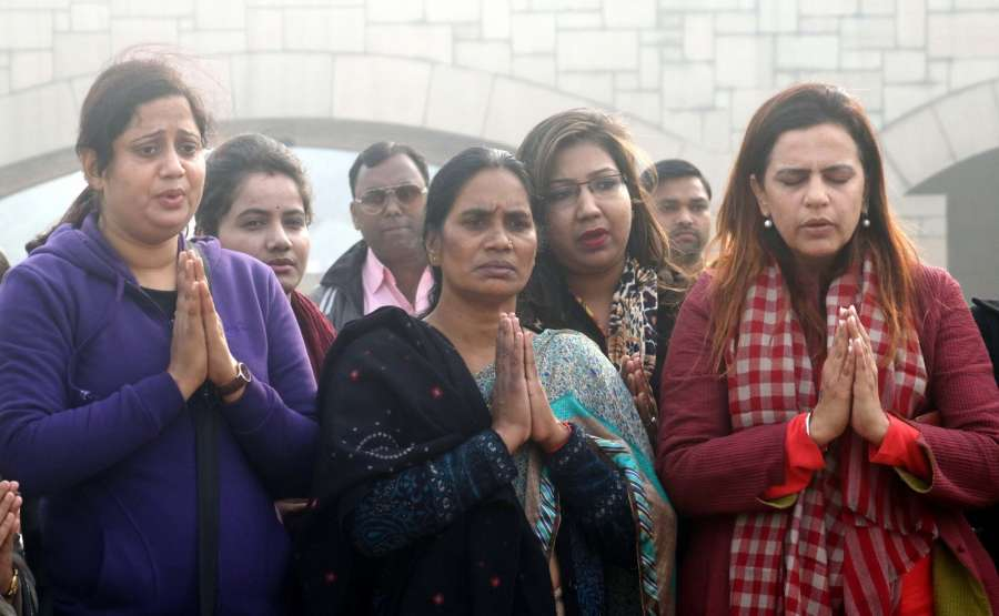 New Delhi: Nirbhaya's mother along with others pay tribute at Mahatma Gandhi's memorial on 4th death anniversary of Nirbhaya gang rape case, in New Delhi on Dec 29, 2016. (Photo: IANS)