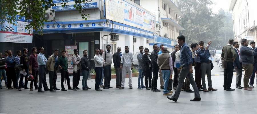 New Delhi: People queue up outside an ATM in New Delhi on Dec 1, 2016. (Photo: IANS)