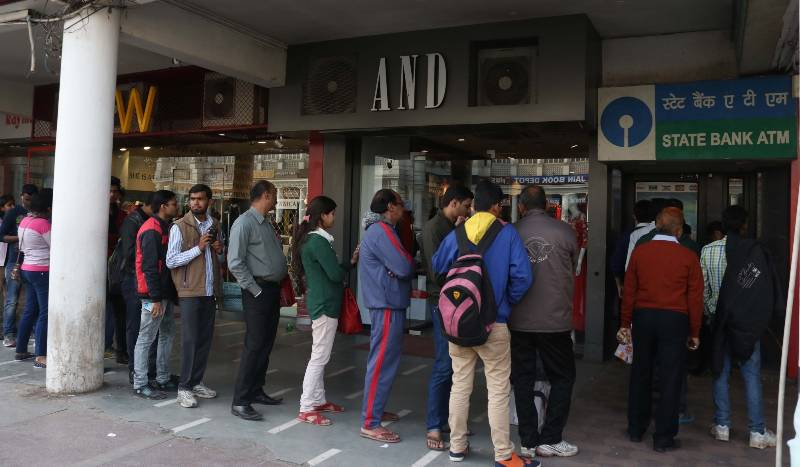 Chennai: People wait in a queue outside a bank branch to exchange old currency notes in Chennai on Nov 10, 2016. (Photo: IANS)
