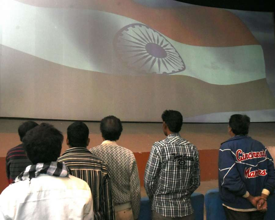 Bikaner: National anthem being played inside a cinema hall before a movie in Bikaner on Dec 2, 2016. The Supreme Court directed cinema halls to play the National Anthem before the start of movies, saying it will instill