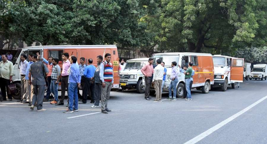New Delhi: Armoured money transport vehicles stand outside the RBI building to carry away Rs 500 and Rs 1000 notes following their demonetization in New Delhi Nov. 9, 2016. (Photo: IANS)