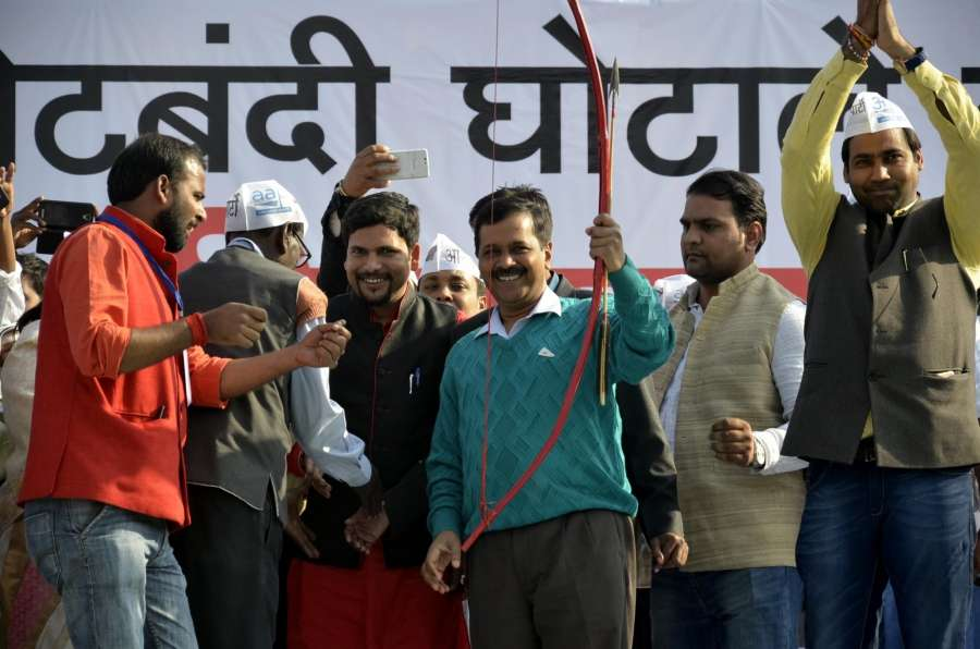 Delhi Chief Minister and AAP leader Arvind Kejriwal holds a bow and an arrow during a party rally in Ranchi on Dec 22, 2016. (Photo: IANS)