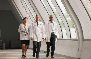 Doctors walking together in hospital corridor