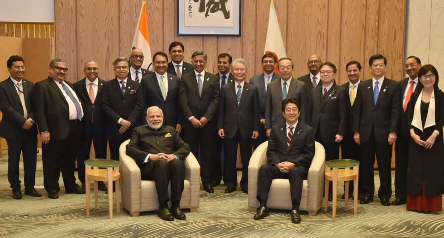 Tokyo: Prime Minister Narendra Modi and Japan's Prime Minister Shinzo Abe with the members of India-Japan Business Leaders' Forum in Tokyo, Japan on Nov 11, 2016. (Photo: IANS/PIB)