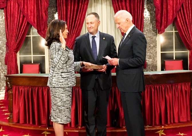 Washington: Vice President Joseph Biden administers the oath of office to Kamala Harris, thefirst Indian American elected to Senate. She swore on a Bible held by her husband Doug Emhoff, (center) in Washington D.C. on Jan 3, 2016. (Photo: Maya Harris on Twitter/IANS)