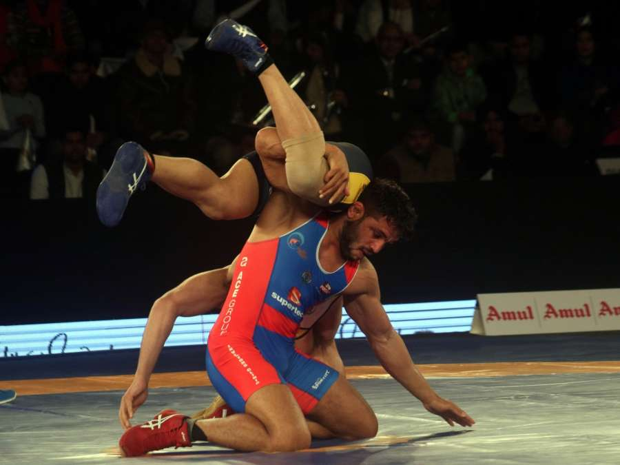 New Delhi: Amit Dhankar (in Blue) of UP Dangal and Pritam (in Yellow) of Mumbai Maharathi in action during a Pro Wrestling League (PWL) 2017 match in New Delhi, on Jan 7, 2017. (Photo: IANS)