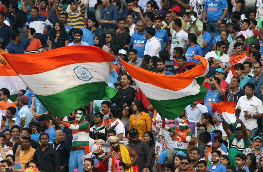 Pune: A fans of the Indian cricket team waves the national flag during the 1st ODI match between India and England at the Maharashtra Cricket Association Stadium in Pune on Jan 15, 2017. Also seen (Photo: Surjeet Yadav/IANS)