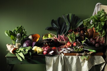Fruits and vegetables on table by .