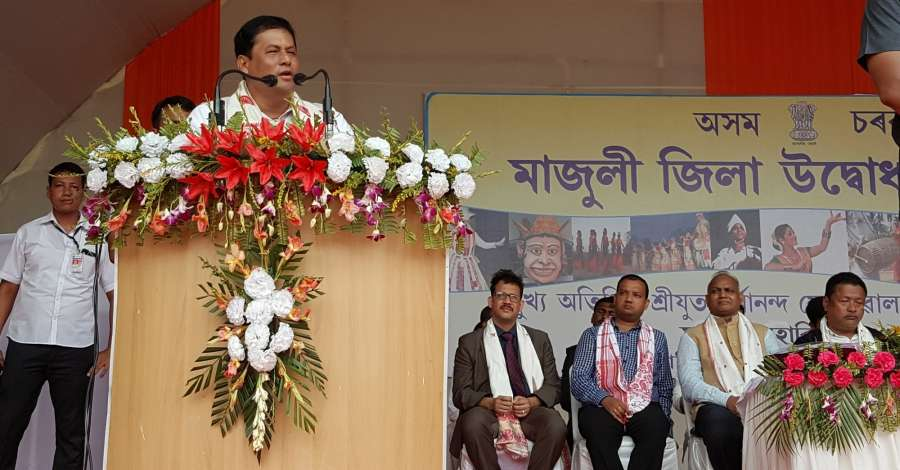 Majuli: Chief Minister Sarbananda Sonowal addressing a mass gathering on the occasion of inauguration of Majuli as the 35th District of Assam in Majuli on Sept 8, 2016. (Photo: IANS) by .