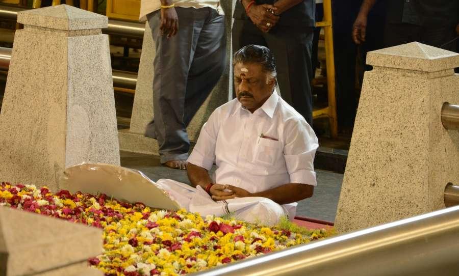 Chennai: Tamil Nadu Chief Minister O. Panneerselvam sitting in meditation in front former Tamil Nadu CM Jayalalithaa's memorial at Chennai's Marina beach on Feb. 7, 2017. (Photo: IANS) by .
