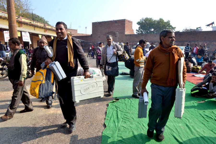 Agra: Poll personnel leave for their respective polling booths with EVMs from Agra ahead of the Uttar Pradesh Assembly Polls on Feb 10, 2017. (Photo: Pawan Sharma/IANS) by .