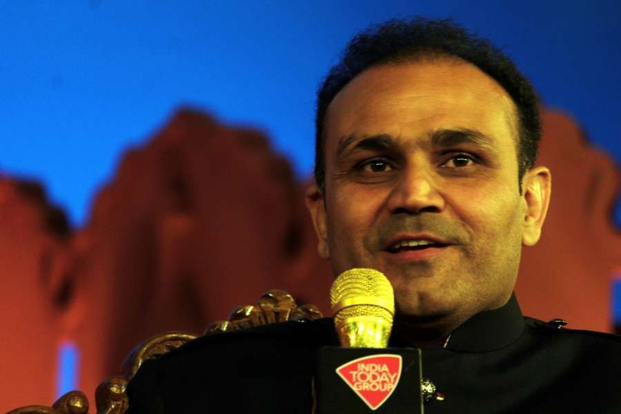 """New Delhi: Former Indian cricketer Virender Sehwag addresses at """"Agenda Aaj Tak"""" in New Delhi on Dec 7, 2016. (Photo: IANS) by ."""