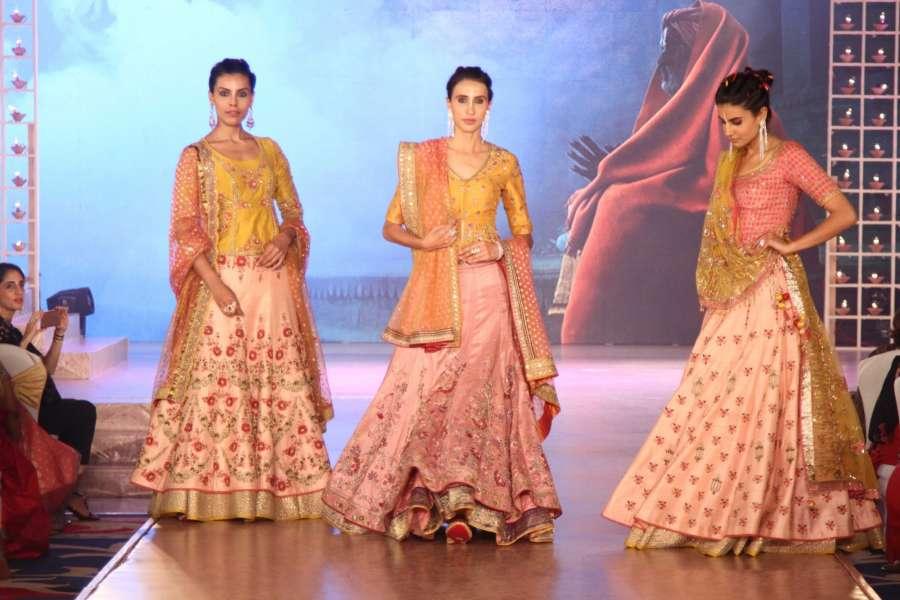 Mumbai: Models walk the ramp during Archana Astitwa Awards 2017 in Mumbai on March 7, 2017. (Photo: IANS) by .