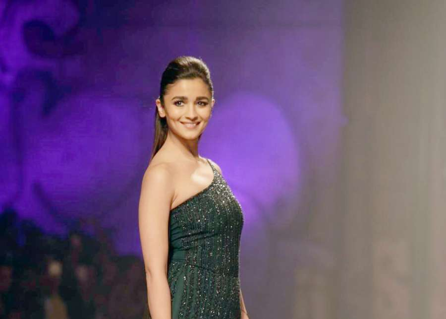 New Delhi: Actress Alia Bhatt walks the ramp for fashion designer Namrata Joshipura during the Amazon India Fashion Week Autumn Winter 2017 in New Delhi on March 17, 2017. (Photo: Amlan Paliwal/IANS) by .