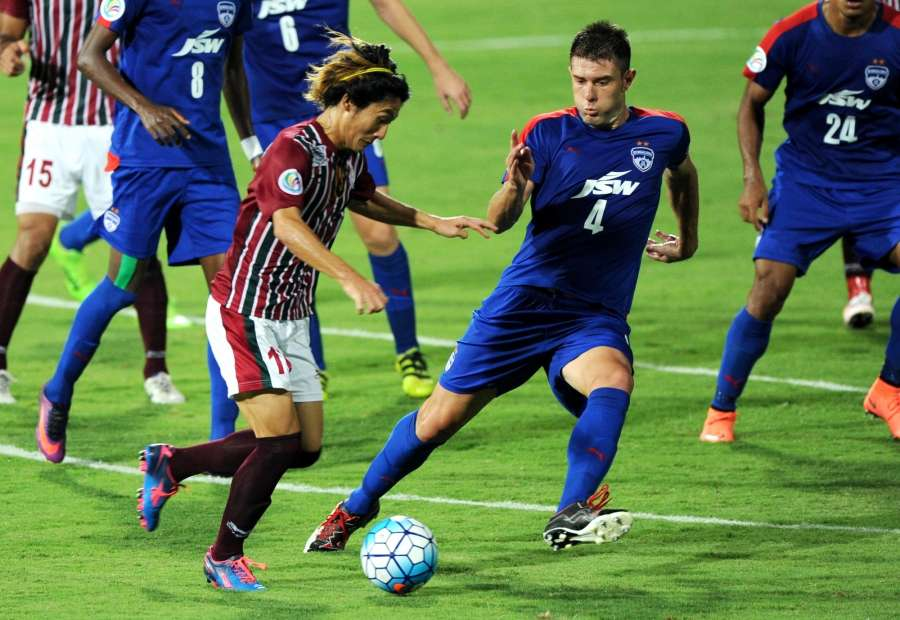 Bengaluru: Players in action during the AFC Cup match between Mohun Bagan and Bengaluru FC at Kanteerava Stadium, in Bengaluru on March 14, 2017. (Photo: IANS) by .