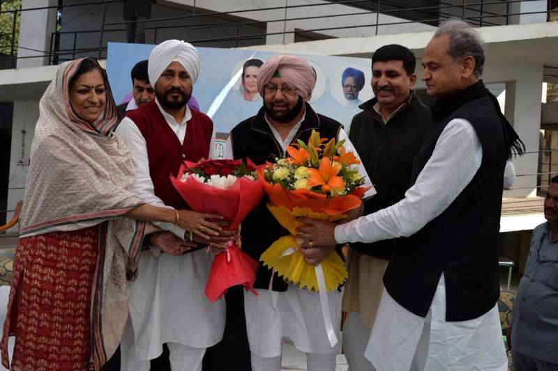 Chandigarh: State Congress Chief Amarinder Singh being welcomed by AICC general secretary in-charge of Punjab affairs, Asha Kumari, Ashok Gehlot and Harish Chaudhary during Congress Legislative Party meet in Chandigarh on March 12, 2017. (Photo: IANS) by .