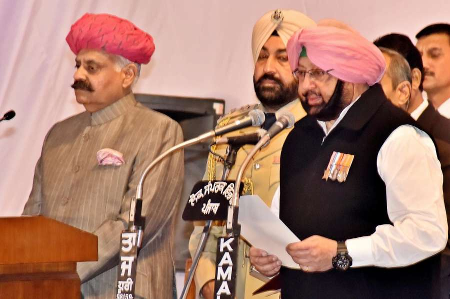 Chandigarh: Punjab Governor VP Singh administer the oath to Captain Amarinder Singh as Chief Minister of Punjab during the swearing in ceremony in Chandigarh, on March 16, 2017. (Photo: IANS) by .