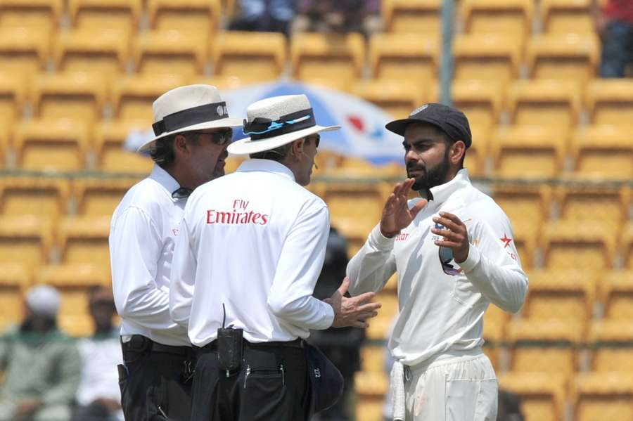 Bengaluru: Indian captain Virat Kohli talks to the umpires during the fourth day of the second test match between India and Australia at M. Chinnaswamy Stadium in Bengaluru on ​March 7, 2017. (Photo: IANS)​​ by .