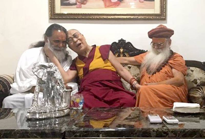 Mathura: Tibetan spiritual leader Dalai Lama (C) meets Karshni Guru Maha Mandaleshwar Sharnanad Maharaj (R) during his visit to Karshni Ashram Raman Reti in Mathura on March 20, 2017. (Photo: IANS) by .
