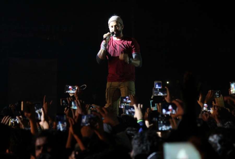 "Nagpur: Indian film director, screenwriter, producer, actor, playback singer, lyricist Farhan Akhtar performs during "" Nagpur Mahotsav 2016"" at Yashwant Stadium in Nagpur on Dec 19, 2016. (Photo: IANS) by ."