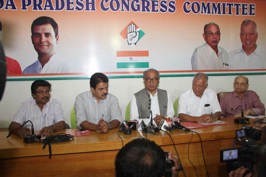 Panaji: Congress General Secretary Digvijay Singh with state Congress leaders briefing media at Congress House in Panaji on March 12, 2017. (Photo: IANS) by .