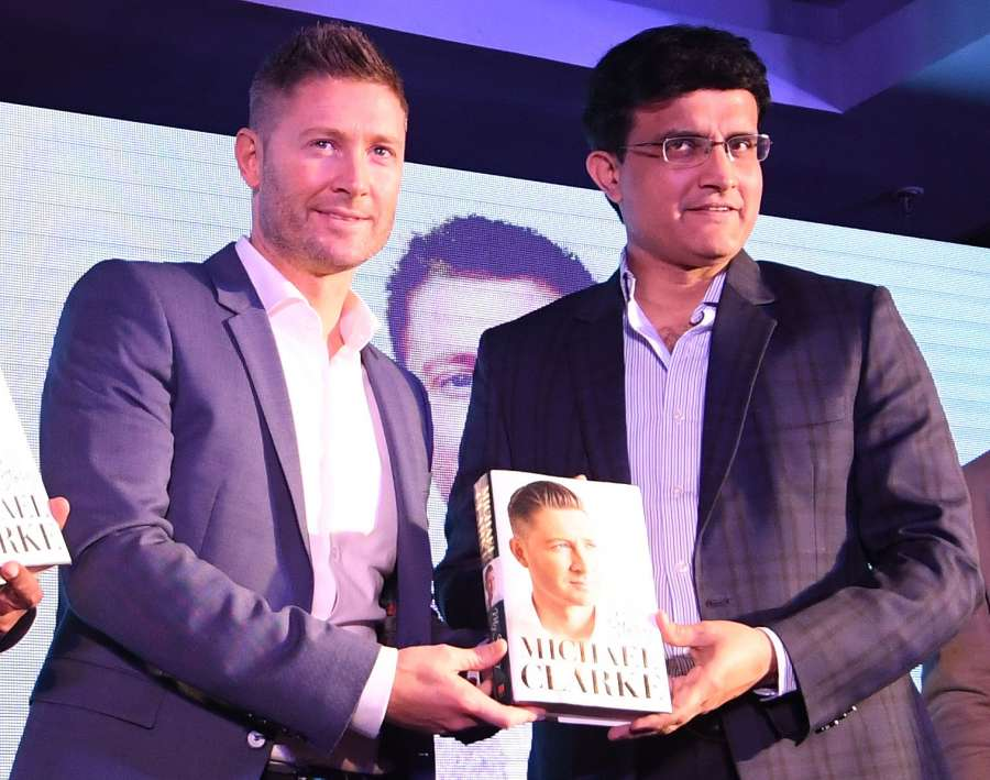 Kolkata: CAB president Saurav Ganguly and former Australia captain Michael Clarke during the launch of Michael Clarke's autobiography 'My Story' in Kolkata on March 14, 2017. (Photo: IANS) by .