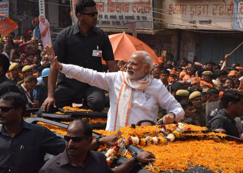 Varanasi: Prime Minister Narendra Modi during a roadshow in Varanasi on March 4, 2017. (Photo: IANS) by .