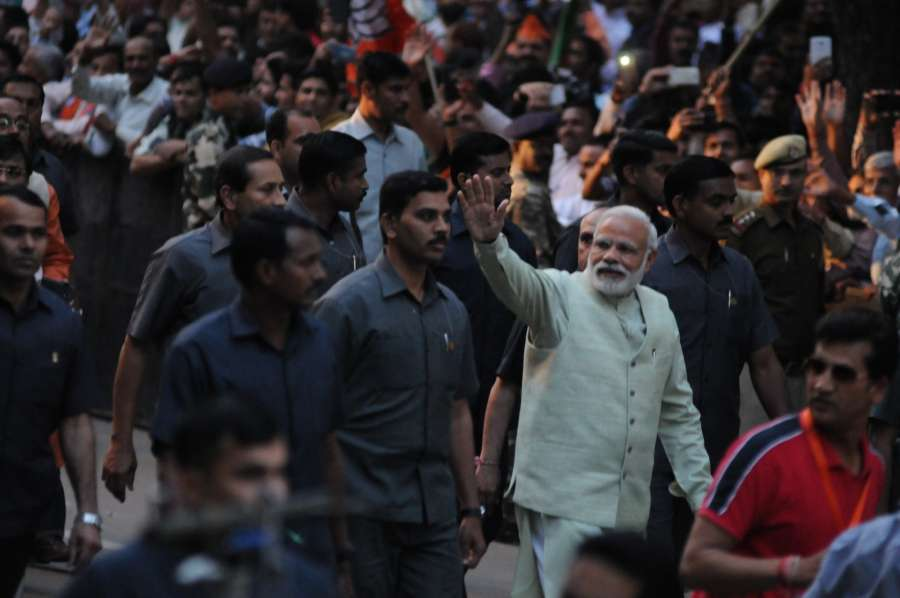 Prime Minister Narendra Modi greeting supporters during a road show at BJP party office in New Delhi on March 12, 2017. (Photo: IANS) by .