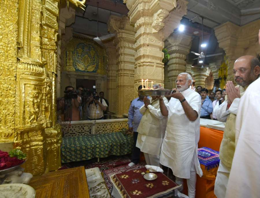 Ahmedabad: Saurashtra: Prime Minister Narendra Modi pays obeisance at Somnath temple in Prabhas Patan near Veraval in Saurashtra, Gujarat on March 8, 2017. Also seen BJP chief Amit Shah. (Photo: IANS/PIB) by .