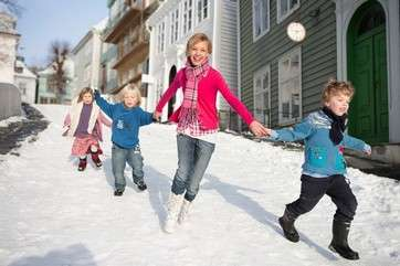 Scandinavian children running in snow by .