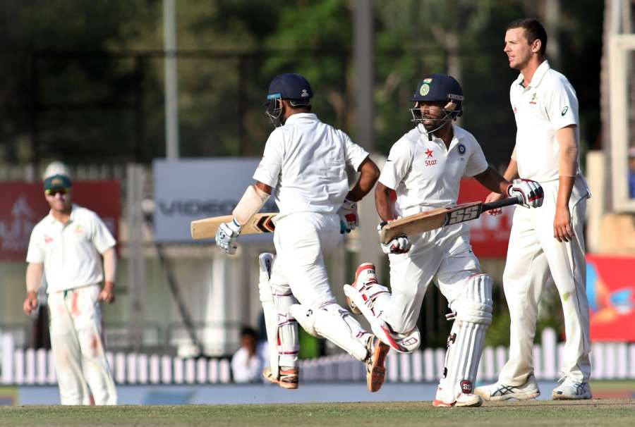 Ranchi: Cheteshwar Pujara and Wriddhiman Saha of India in action during the third day of the third cricket test match between India and Australia at the Jharkhand State Cricket Association (JSCA) Stadium complex in Ranchi on March 18, 2017. (Photo: Surjeet Yadav/IANS) by .