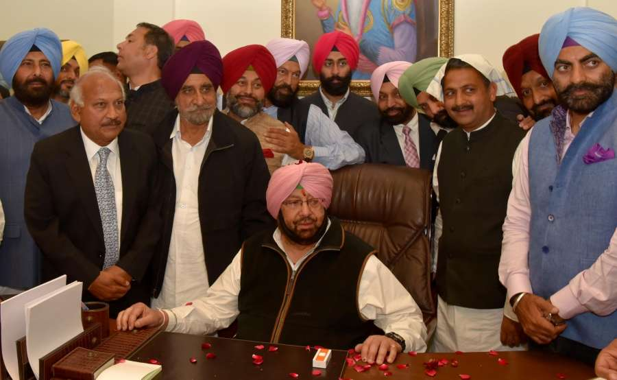 Chandigarh: Captain Amarinder Singh takes charge as the Punjab Chief Minister in Chandigarh on Feb 16, 2017. (Photo: IANS) by .