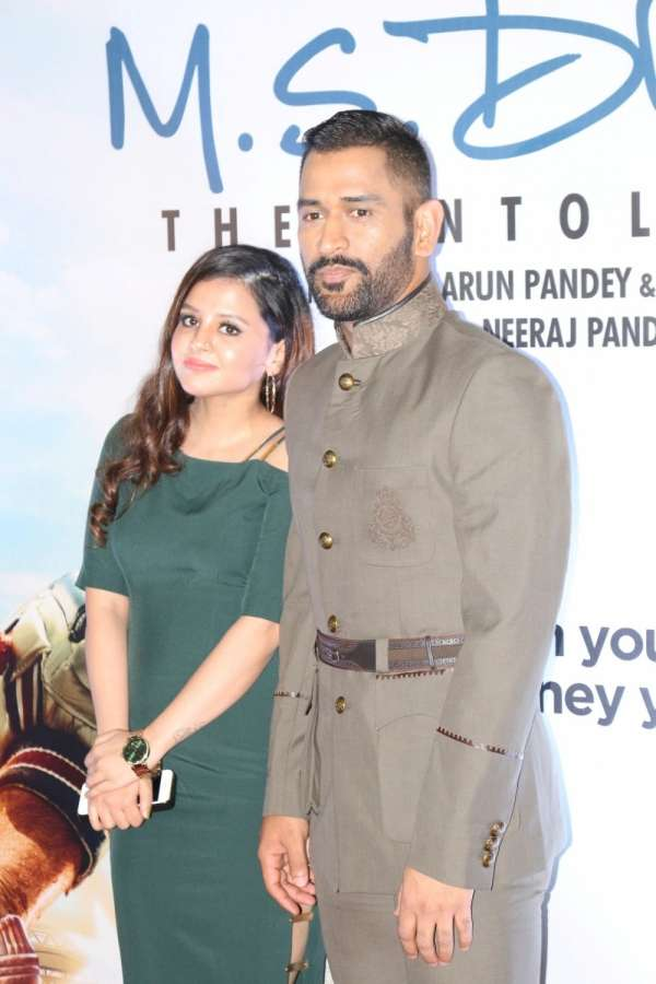 Mumbai: Indian cricket player Mahendra Singh Dhoni along with his wife Sakshi Dhoni during the screening of film M S Dhoni, in Mumbai, on Sept 29, 2016. (Photo: IANS) by .