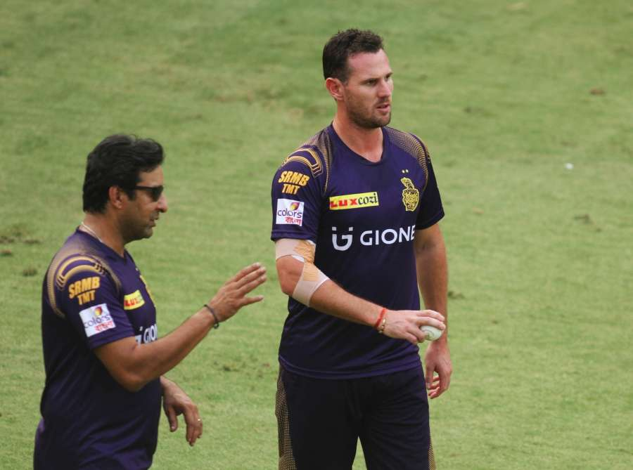 New Delhi: Kolkata Knight Riders player Shaun Tait and coach Wasim Akram during a practice session at Feroz Shah Kotla Stadium, in New Delhi on May 24, 2016. (Photo: Surjeet Yadav/IANS) by .