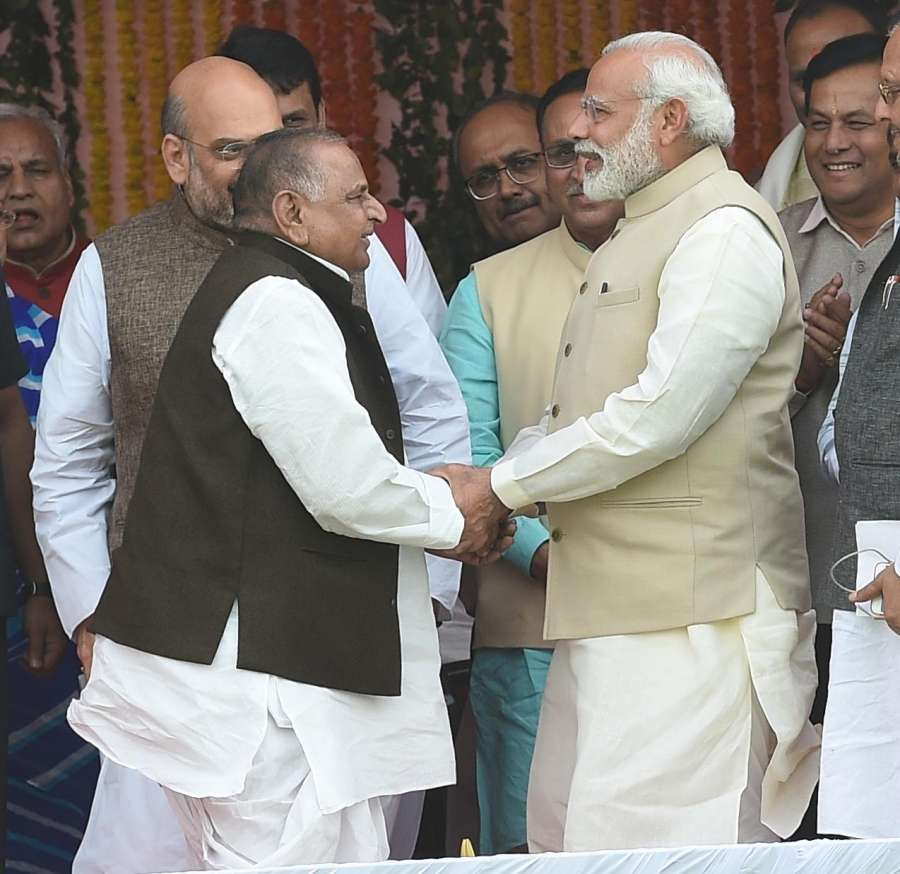 Lucknow: Prime Minister Narendra Modi greeting Samajwadi Party leader Mulayam Singh Yadav during the swearing-in ceremony of Yogi Adityanath as Uttar Pradesh Chief Minister in Lucknow on March 19, 2017. (Photo: IANS) by .