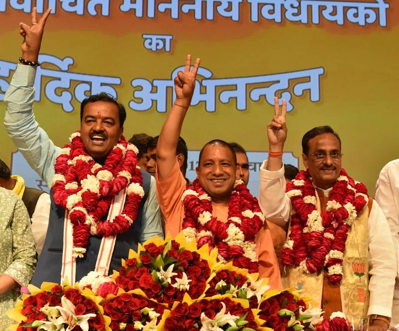 Lucknow: BJP's Uttar Pradesh Chief Minister designate Yogi Adityanath (C) with Deputy Chief Ministers designate Keshav Prasad Maurya (L) and Dinesh Sharma (R) during a press conference in Lucknow on March 18, 2017. (Photo: IANS) by .