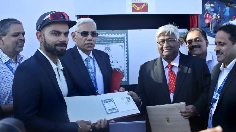 Pune: Indian cricket captian Virat Kohli with Chairman of Committee of Administrators, BCCI, Vinod Rai unveiling a stamp to commemorate Indian vs Australia Test series on the day one of the first test match between India and Australia held in Pune on Feb. 23, 2017. (Photo Surjeet Yadav /IANS) by .