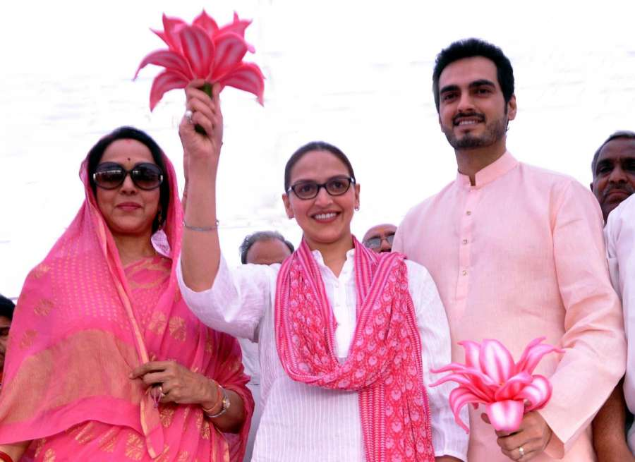 BJP candidate from Mathura, Hema Malini with her daughter actress Esha Deol and her husband Bharat Takhtani during campaigning for Lok Sabha election in Mathura on April 12, 2014. (Photo: IANS) by .